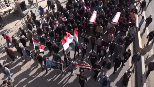 hundreds of iraqis mourn two reporters shot dead late friday in the country's southern city of basra where they had been covering months of anti... - iraq stock videos & royalty-free footage