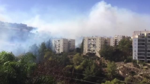 hundreds of israelis fled their homes on the outskirts of the country's third city haifa on thursday with others trapped inside as firefighters... - haifa stock videos and b-roll footage