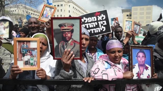 hundreds of israelis of ethiopian decent demonstrated in front of the prime ministers office in jerusalem on sunday to demand that their families... - ethiopia stock videos & royalty-free footage