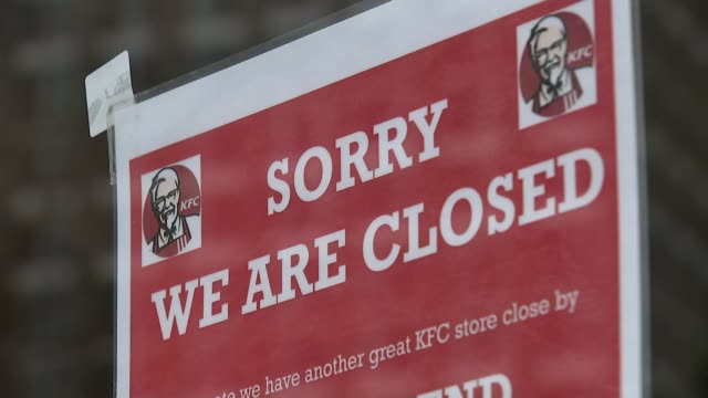 hundreds of kfc restaurants closed due to delivery problems england london ext 'kfc' signs workers putting up 'sorry we are closed' sign in window... - closed sign stock videos and b-roll footage