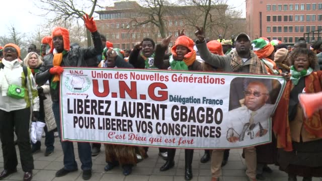 hundreds of laurent gbagbo loyalists protested in the hague on tuesday ahead of the former ivorian presidents pre trial hearing at the international... - international criminal court stock videos and b-roll footage