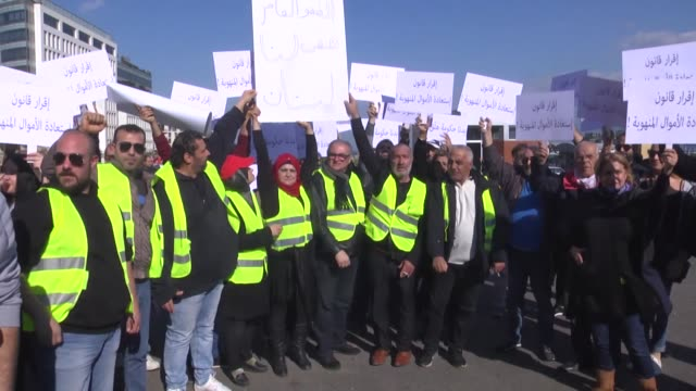 hundreds of lebanese people some wearing yellow vests gather at martyrs' square during an antigovernment protest the living conditions and political... - lebanon country stock videos & royalty-free footage