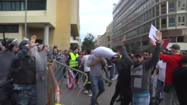 hundreds of lebanese people, some wearing yellow vests, gather at riad al solh square during an anti-government protest against the living conditions... - lebanon country stock videos & royalty-free footage