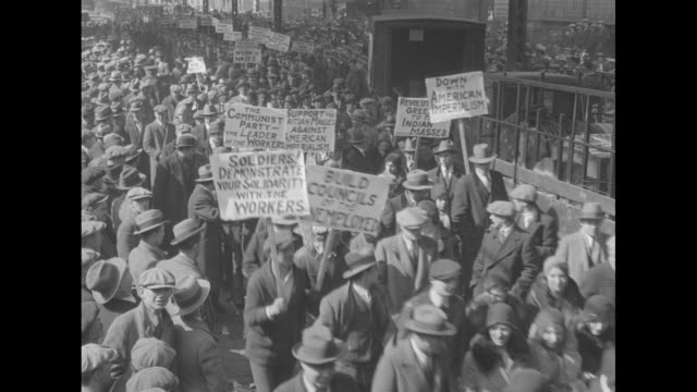 hundreds of men marching while holding placards, 'soldiers demonstrate your solidarity with the workers', 'work for wages' , 'join the communist... - chicago illinois stock videos & royalty-free footage