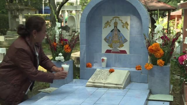 Hundreds of Mexicans began their annual visit to local cemeteries to bring flowers candles and drinks to love ones who have passed away