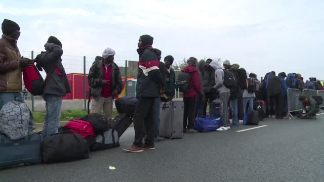 hundreds of migrants packed their bags with a mixture of relief and despair on monday as they left the notorious makeshift camp in the northern... - makeshift stock videos and b-roll footage