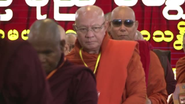 hundreds of monks swathed in saffron and maroon robes file early morning into a yangon monastery for the annual meeting of the buddha dhamma parahita... - maroon stock videos and b-roll footage