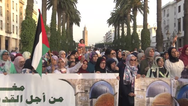 hundreds of moroccans take part in a demonstration in support of alaqsa mosque and in protest against new israeli security measures at the holy site... - al aqsa mosque stock videos and b-roll footage