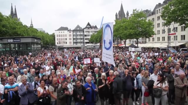 hundreds of muslims gather to protest extremism and terrorism in cologne germany on june 17 2017 - islam stock-videos und b-roll-filmmaterial