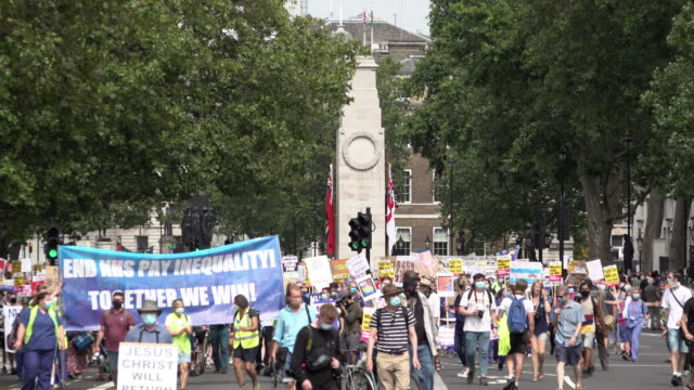hundreds of national health service staff and key workers march past the cenotaph on the pay justice social distancing protest demanding a 15 percent... - memorial stock videos & royalty-free footage