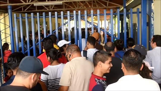 Hundreds of Nicaraguans wait in line at a government office to apply for travel documents in order to be able to emigrate as the country is still...