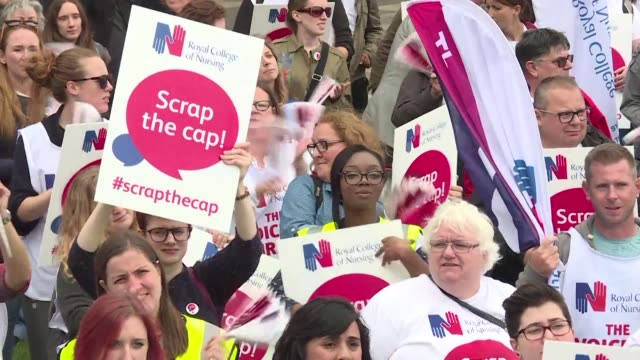 hundreds of nurses from britain's national health service protest outside the houses of parliament in london demanding an end to the government's pay... - end cap stock videos & royalty-free footage