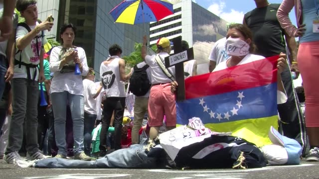 hundreds of opposition supporters march in caracas over food shortages insecurity and censorship imposed by the government while chavistas visit the... - censorship stock videos and b-roll footage