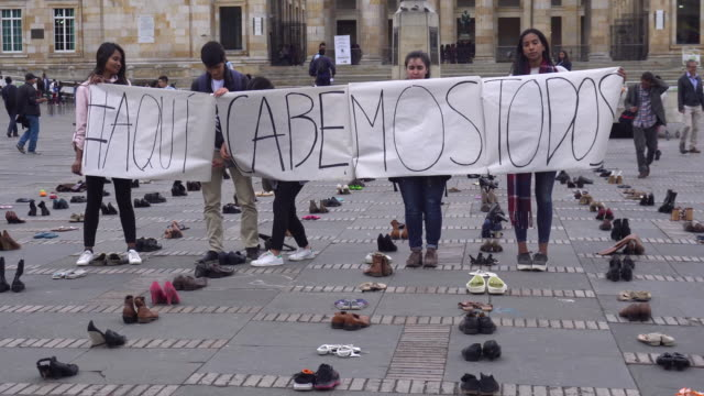 hundreds of pairs of shoes from venezuelan migrants are laid out in bolivar square in bogota colombia as part of a protest against xenophobic... - pair stock videos & royalty-free footage