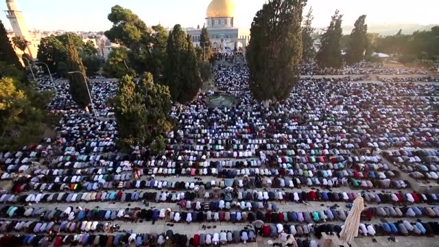 hundreds of palestinian men performed the morning eid al fitr prayer near the dome of the rock at the al aqsa compound islams third most site in the... - compounding stock videos and b-roll footage