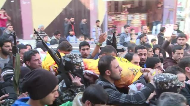 vídeos de stock, filmes e b-roll de hundreds of palestinians attended wednesday in the jabalia refugee camp in the northern gaza strip the funeral of mussa abu zuaiter, who was killed... - air raid