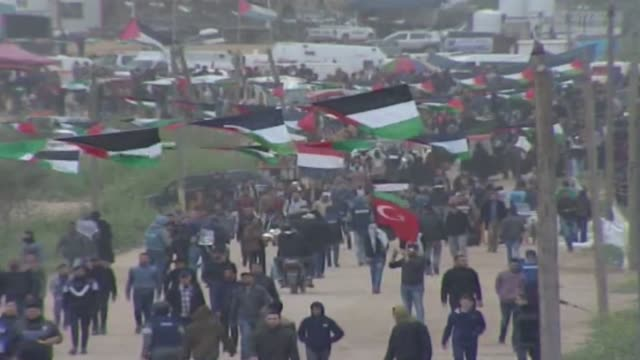 hundreds of palestinians began to converge on the gazaisrael buffer zone on saturday to take part in mass rallies marking the first anniversary of... - jihad stock videos & royalty-free footage