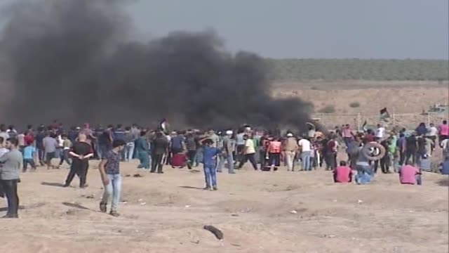 Hundreds of Palestinians converge along the GazaIsrael security fence on July 06 2018 to take part in ongoing rallies against Israel's decadeslong...