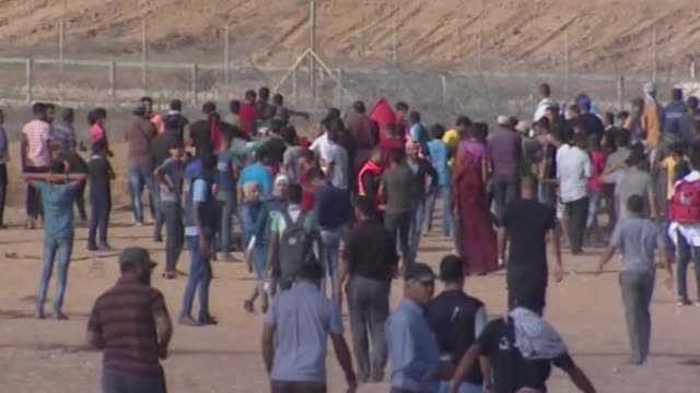 Hundreds of Palestinians converge along the GazaIsrael security fence on July 13 2018 to take part in ongoing rallies against Israel's decadeslong...