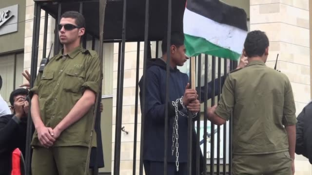 hundreds of palestinians marched in gaza city on wednesday as a show of solidarity with palestinian prisoners held in israeli facilities clean... - prisoner stock videos and b-roll footage