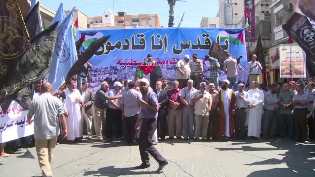 hundreds of palestinians protested in gaza city on friday denouncing clashes between palestinians and israeli police at jerusalems flashpoint al aqsa... - compounding stock videos and b-roll footage