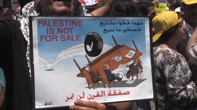 vídeos de stock, filmes e b-roll de hundreds of palestinians take part in a demonstration a rally in the occupied west bank city of ramallah on june 24 2019 to protest a usled... - ramallah