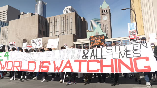 hundreds of peaceful protesters marched through downtown minneapolis as former police officer derek chauvin faces murder charges in the death of... - downtown stock videos & royalty-free footage