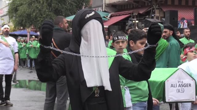 hundreds of people attend the international mourning ritual of ashura to mark the anniversary of the martyrdom of imam alhussain a grandson of... - kars stock videos & royalty-free footage