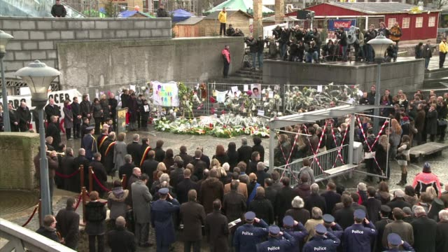 Hundreds of people clad in white marched in silence in the Belgian city of Liege Saturday to mourn five people killed when a former convict went on a...