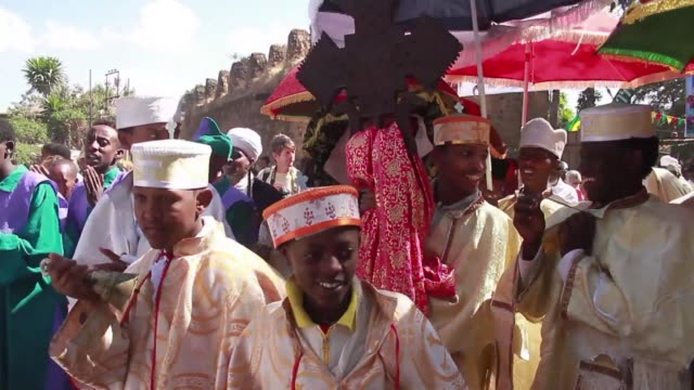 hundreds of people cloaked in white shrouds and chanting biblical hymns gather from the early hours at the holy baths in northern ethiopia to... - religious illustration stock videos and b-roll footage