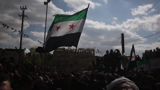 hundreds of people demontrated friday in syria's rebel-held city of duma to protest against the regime of bashar al-assad, waving massive syrian... - revolution stock videos & royalty-free footage