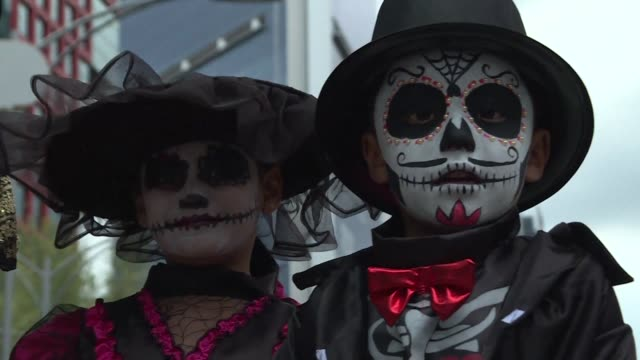 Hundreds of people dressed up as Catrina a Mexican representation of death and take part in a parade in Mexico City ahead of the Day of the Dead