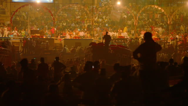 hundreds of people gather for ganga aarti on the banks of the ganges, varanasi, uttar pradesh, india. - ceremony stock videos & royalty-free footage