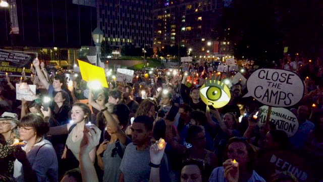 """hundreds of people gather in lower manhattan for a """"lights for liberty"""" protest against migrant detention camps and the impending raids by... - emigration and immigration stock videos & royalty-free footage"""