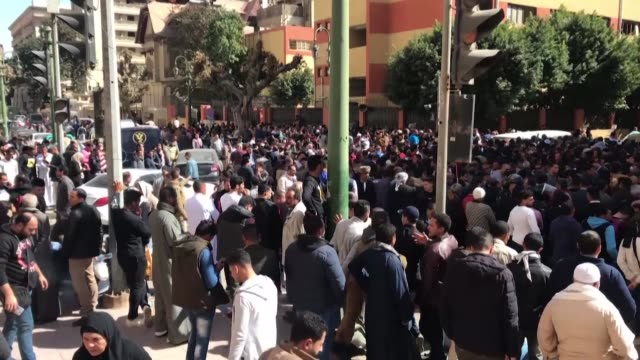 hundreds of people gather outside the egyptian ministry of health to undergo medical tests for coronavirus as this was announced as a new requirement... - egypt stock videos & royalty-free footage