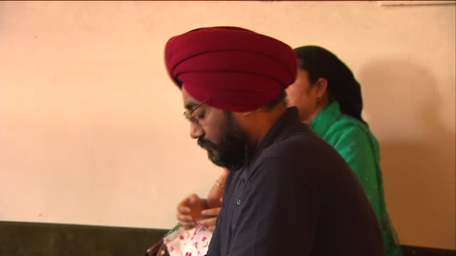 wgn hundreds of people gathered at sikh temples to hold vigils for the 6 sikhs shot and killed in oak creek wisconsin on august 07 2012 in chicago... - mourner stock videos & royalty-free footage