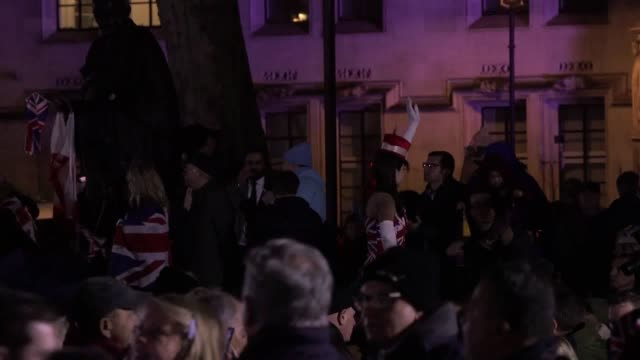 hundreds of people gathered at westminster for a brexit celebration to mark the uk leaving the european union a music system was set up on the back... - dancing back to back stock videos & royalty-free footage