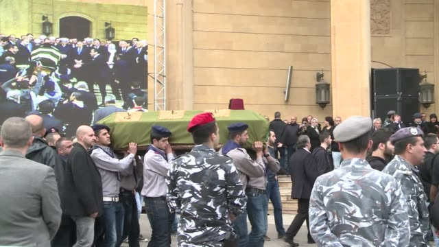 hundreds of people gathered in beirut on sunday for the burial of mohammad chatah, a prominent lebanese critic of the syrian regime, killed in a... - critic stock videos & royalty-free footage