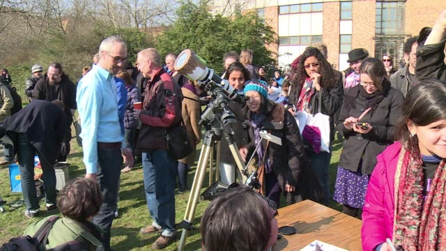 Hundreds of people gathered in Berlin on Friday to catch a glimpse of the solar eclipse