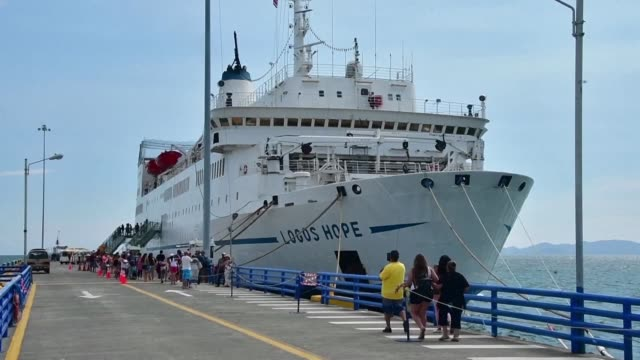 hundreds of people in costa rica visit a floating library and bookstore housing thousands of books operated by a germany christian charity - san jose costa rica stock videos & royalty-free footage