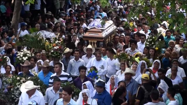 hundreds of people in el salvador attend the funeral of priest walter osmir vasquez jimanez who was murdered by suspected gang members on his way to... - holy week stock videos & royalty-free footage