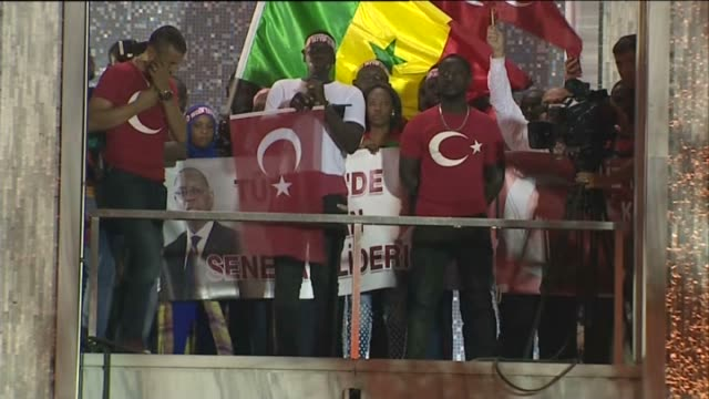 hundreds of people including some senegalese living in turkey gather in front of the istanbul metropolitan municipality building to protest the... - staatsstreich stock-videos und b-roll-filmmaterial