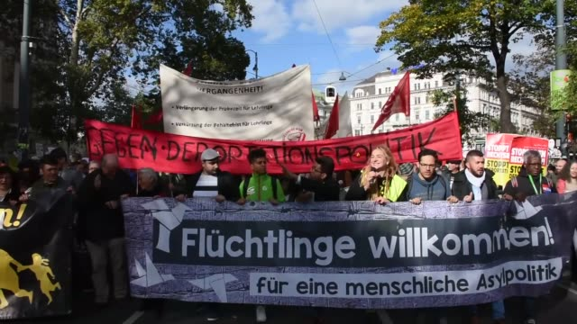hundreds of people march during a demonstration on october 07 2017 in vienna austria against rightwing extremism and racism and express their... - extremism stock videos & royalty-free footage