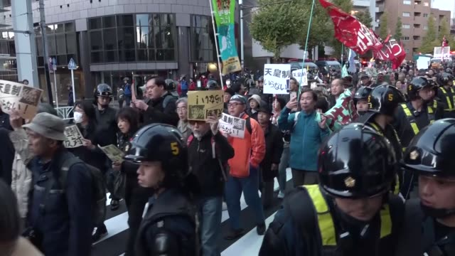 hundreds of people march through the streets of tokyo to protest against the tradition of emperor system in japan on november 26 2017 demonstrators... - royalty stock videos & royalty-free footage