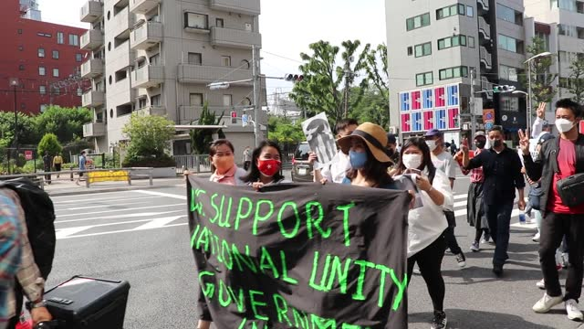 hundreds of people on sunday took to the streets of tokyo, japan to protest human rights violations in asia, demanding respect for freedom and... - china east asia stock videos & royalty-free footage