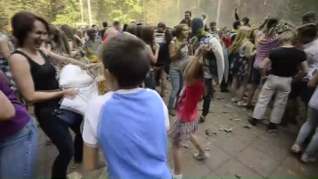 hundreds of people organized via social media attend a pillow fight at the park fili in moscow russia on september 27 2015 - pillow fight stock videos & royalty-free footage