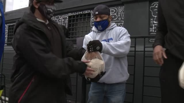 hundreds of people pick up holiday meals at food banks in new york city days before thanksgiving, as the us continues to battle high unemployment... - thanksgiving politics stock videos & royalty-free footage
