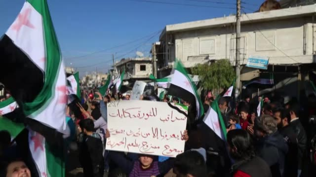 A hundreds of people protest ceasefire violation of Syrian regime after Friday pray in Idlib Syria on January 06 2017