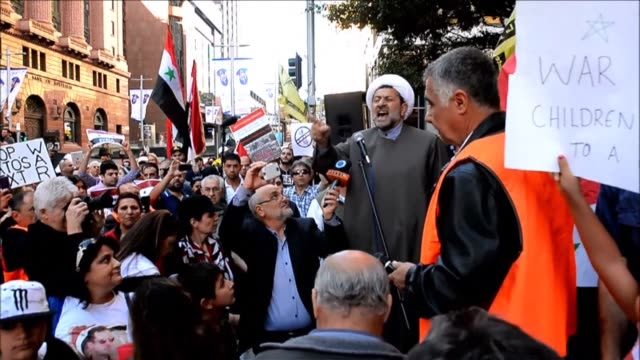 hundreds of people protest in australia against a possible us military strike on syria after president barack obama said washington was weighing... - narrow stock videos & royalty-free footage