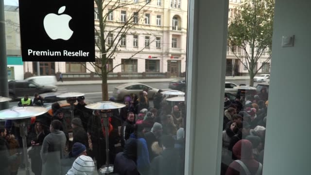 Hundreds of people queue at Moscow's flagship Apple premium reseller store for the new iPhone X as it goes on sale